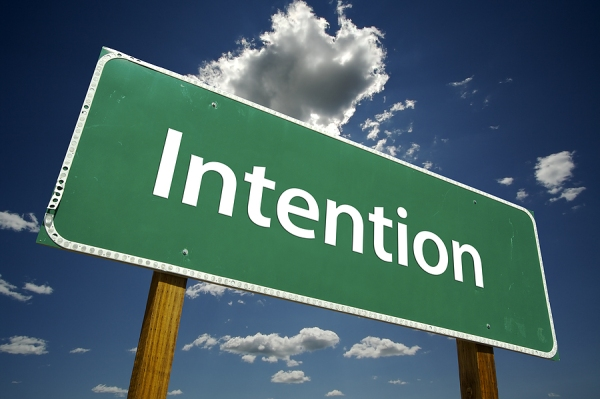 sign with the word Intention on it